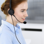 call center; call; operator; business; team; group; woman; happy; support; people; office; businesswoman; headphone; headset; smiling; microphone; work; executive; staff; help desk; working; telemarketing; consultant; teamwork; service; communication